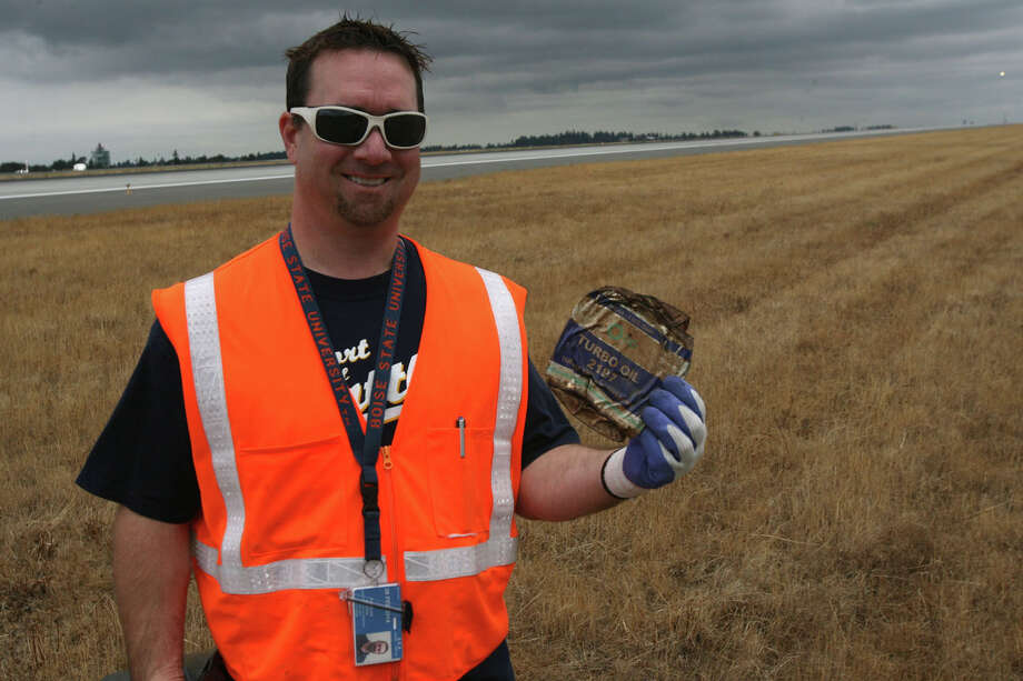 Devron Knowles, a Port of Seattle network engineer, shows an old oil can he found during Seattle-Tacoma International Airport's annual FOD Walk on Wednesday, Aug. 22, 2012. Photo: Aubrey Cohen/seattlepi.com Staff