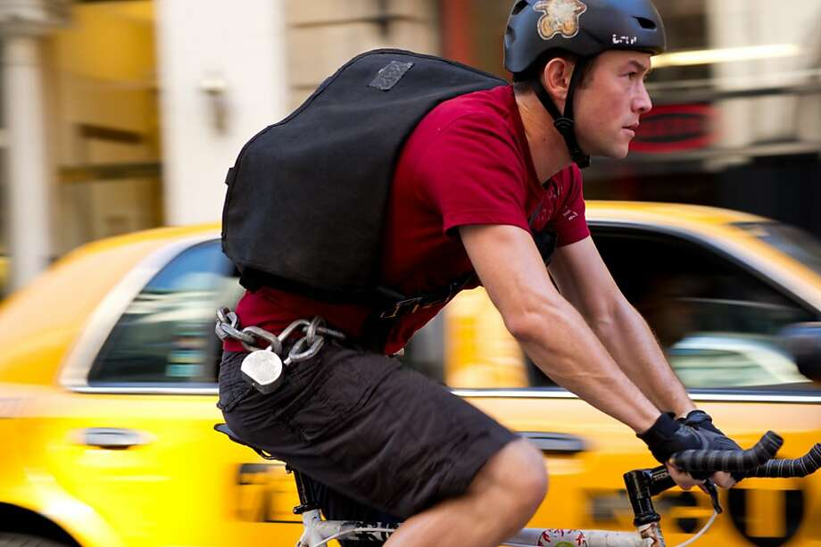 "Bike messenger Wilee (Joseph Gordon-Levitt) picks up more than he bargained for in ""Premium Rush."" Photo: Sarah Shatz, Columbia Pictures"