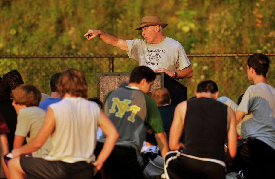 Head coach Tom Taylor speaks to his players during Immaculate High School football practice in Danbury on Wednesday, Aug. 22, 2012. Photo: Jason Rearick / The News-Times