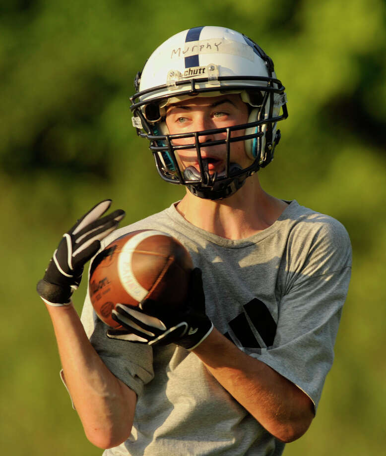 Shane Murphy catches a ball during Immaculate High School football practice in Danbury on Wednesday, Aug. 22, 2012. Photo: Jason Rearick / The News-Times
