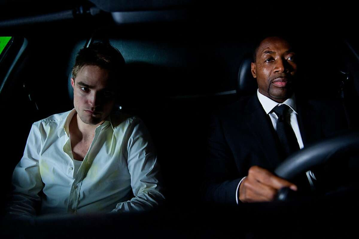 Robert Pattinson (left) stars as ?'Eric Packer?