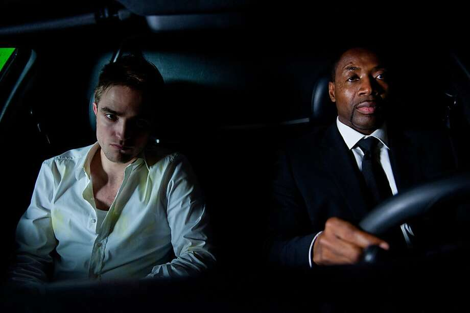 "Billionaire Eric (Robert Pattinson, left) and Ibrahim (Abdul Ayoola) traverse Manhattan in ""Cosmopolis."" Photo: Entertainment One"