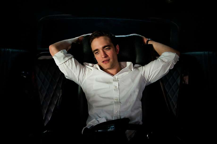 "Billionaire Eric Packer (Robert Pattinson) takes a wild ride on his way to a haircut in ""Cosmopolis."" Photo: Entertainment One"