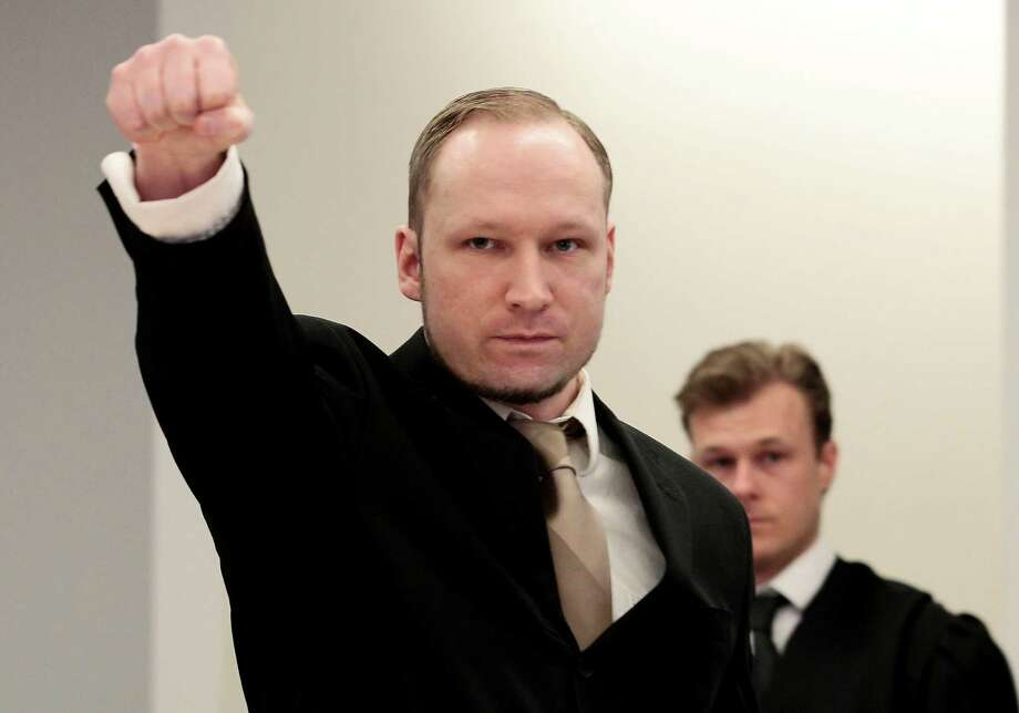 FILE - In this Tuesday, April 17, 2012 file photo, accused Norwegian Anders Behring Breivik gestures as he arrives at the courtroom, in Oslo, Norway. Those expecting Anders Behring Breivik to spend the rest of his days alone in a cramped cell will be disappointed when the far-right fanatic receives his sentence Friday for killing 77 people in a bomb and gun rampage last year. If declared insane, the confessed killer will be the sole patient of a psychiatric ward that Norway built just for him, with 17 people on staff to treat him. If found mentally fit, he will remain isolated, for now, in the high-security prison where he disposes of three 86-square-foot (8-square-meter) cells: a bed room, an exercise room and a study. (AP Photo/Hakon Mosvold Larsen/Scanpix Norway, Pool, File) Photo: Hakon Mosvold,Larsen / AP