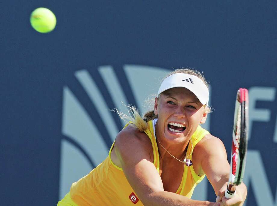 Caroline Wozniacki, of Denmark, hits a backhand during her 7-6 (4), 6-2 victory over Sofia Arvidsson, of Sweden, at the New Haven Open tennis tournament in New Haven, Conn., on Wednesday, Aug. 22, 2012. Photo: Fred Beckham