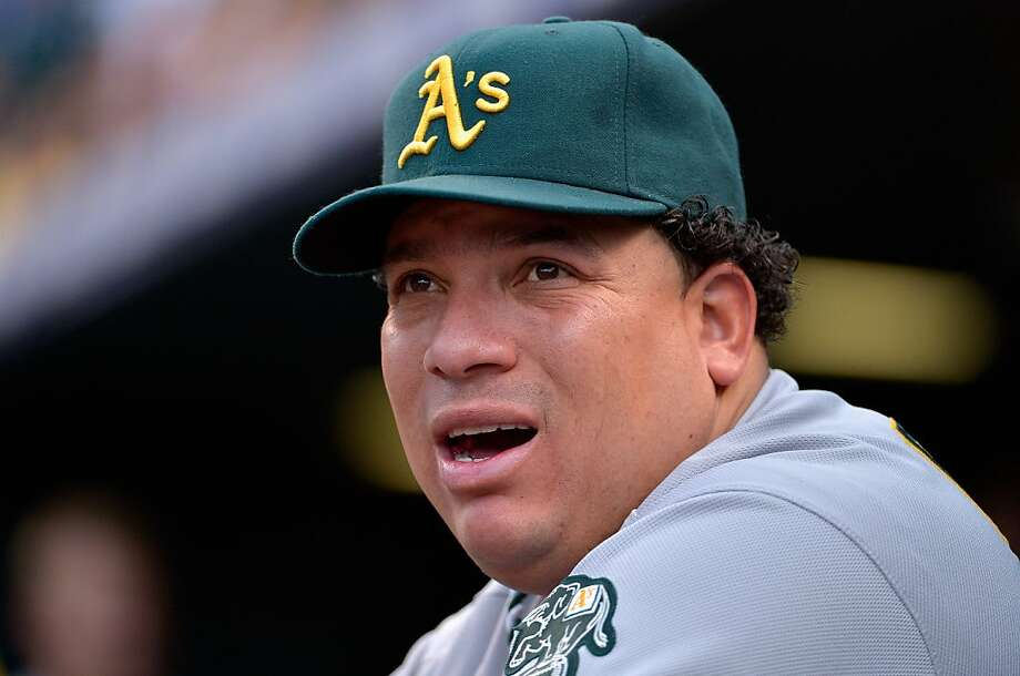 FILE - AUGUST 22, 2012:  It was reported that pitcher Bartolo Colon of the Oakland Athletics was suspended for 50 games after testing positive for testosterone August 22, 2012. DENVER, CO - JUNE 12:  Starting pitcher Bartolo Colon #21 of the Oakland Athletics looks on from the dugout as he earned the win against the Colorado Rockies in an 8-5 win during Interleague Play at Coors Field on June 12, 2012 in Denver, Colorado.  (Photo by Doug Pensinger/Getty Images) Photo: Doug Pensinger, Getty Images