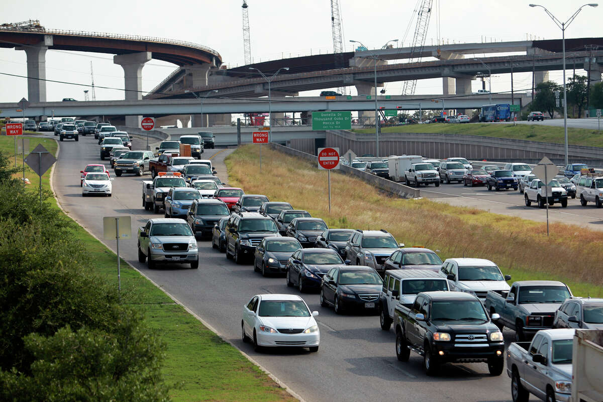 Northbound cars wait to merge with other commuters as traffic snarls around the construction area of 281 and 1604 on the north side of San Antonio on August 22, 2012.