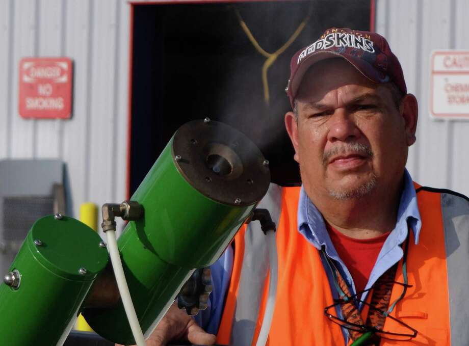 Roger Aguilar of Bexar County vector control tests fogging equipment before driving into the field to eradicate mosquitos at the Southton Service Center on Wednesday, Aug. 22, 2012. The county recently recorded its first West Nile virus death. Photo: Billy Calzada, San Antonio Express-News / © San Antonio Express-News