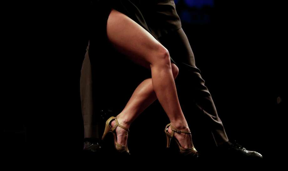 A tango couple competes in a stage category at the Tango Dance World Cup 2012 in Buenos Aires, Argentina, Wednesday, Aug. 22, 2012. The two-week long event offers hundreds of free dance lessons, concerts and recitals, as professional dancers compete in the championship and teach many the eight basic steps of the dance in the city where it was born. (AP Photo/Natacha Pisarenko) Photo: Natacha Pisarenko, Associated Press / AP