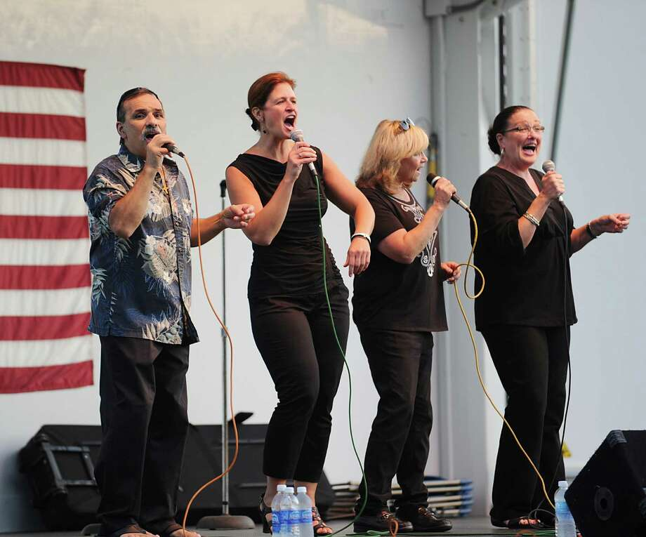 In Harmony, a Danbury-based oldies group, performs at Roger Sherman Baldwin Park in Greenwich, Wednesday night, Aug. 22, 2012. Photo: Bob Luckey / Greenwich Time