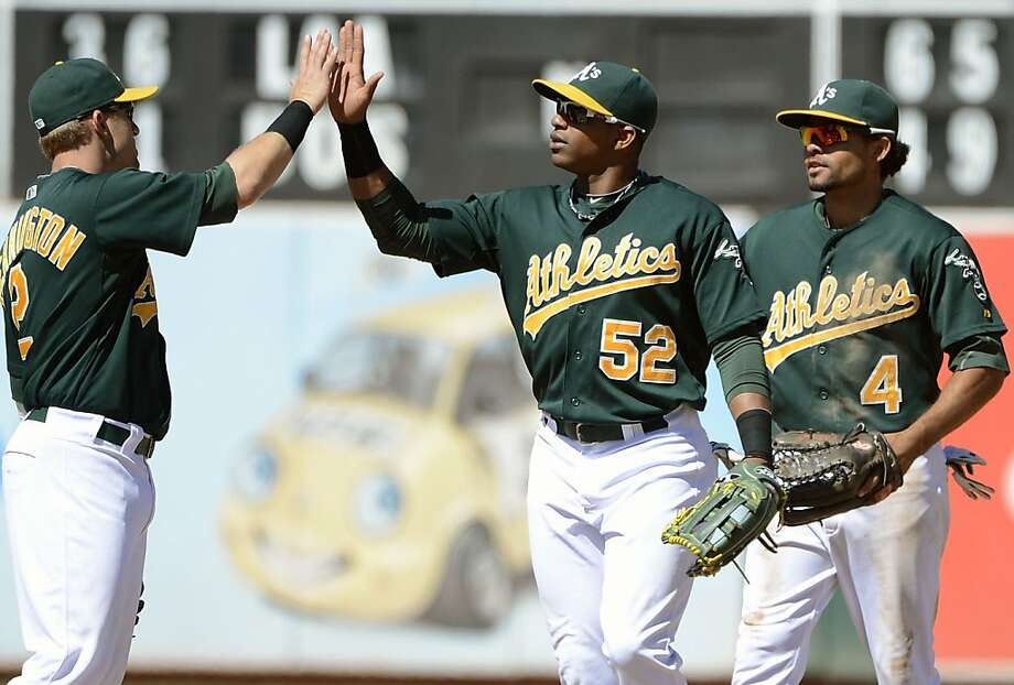 OAKLAND, CA - AUGUST 22:  Cliff Pennington #2, Yoenis Cespedes #52, and Coco Crisp #4 of the Oakland Athletics celebrates defeating the Minnesota Twins 5 to 1 at O.co Coliseum on August 22, 2012 in Oakland, California.  (Photo by Thearon W. Henderson/Getty Images) Photo: Thearon W. Henderson, Getty Images