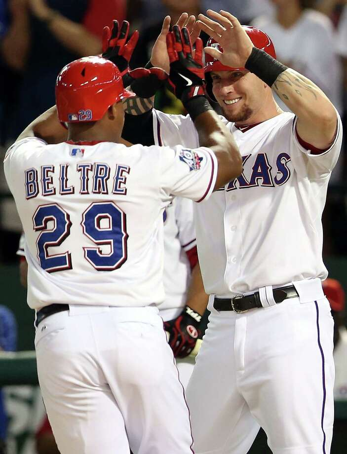 Adrian Beltre is welcomed by teammate Josh Hamilton after hitting his second two-run homer of the fourth inning, and third of the game. Photo: Ronald Martinez, Getty Images / 2012 Getty Images