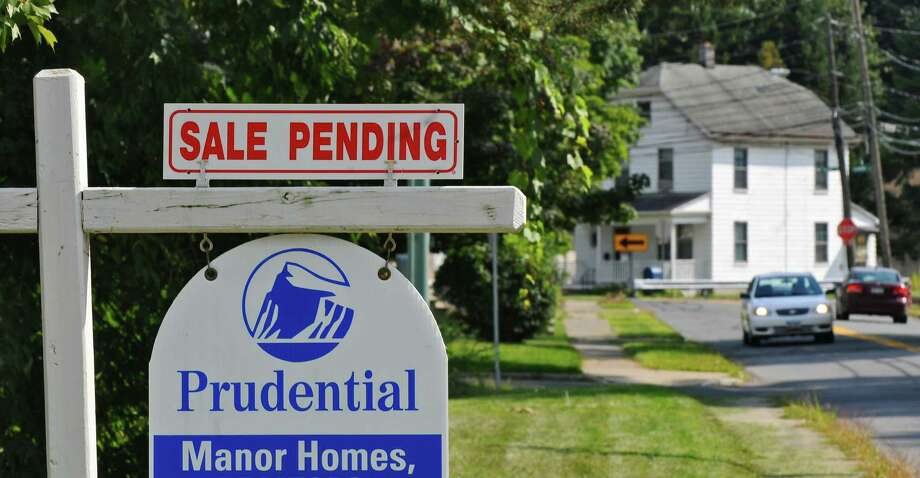 A sale pending sign on a home on South Lake Avenue on Wednesday Aug. 22, 2012 in Troy, NY. (Philip Kamrass / Times Union) Photo: Philip Kamrass / 00018974A