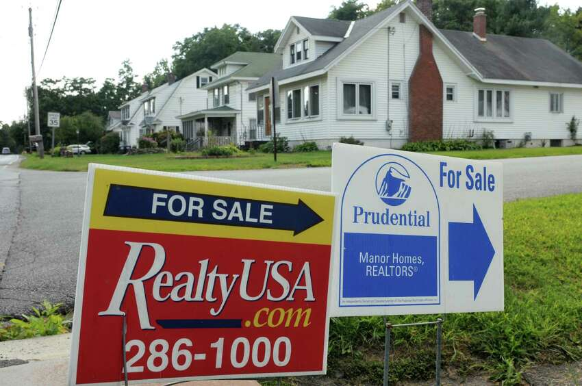 For sale signs on North Lake Avenue on Wednesday Aug. 22, 2012 in Brunswick, NY. (Philip Kamrass / Times Union)