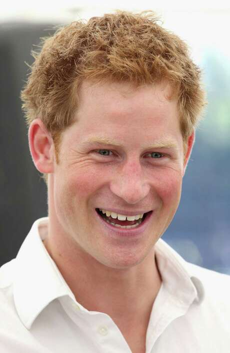 (FILES) In a file picture taken on July 26, 2012 Britain's Prince Harry smiles during a visit to Bacon's College in London. he British royal family said Wednesday nude photographs of Prince Harry cavorting with friends on holiday in Las Vegas were genuine. AFP PHOTO / POOL / CHRIS JACKSONChris Jackson/AFP/GettyImages Photo: CHRIS JACKSON / AFP ImageForum