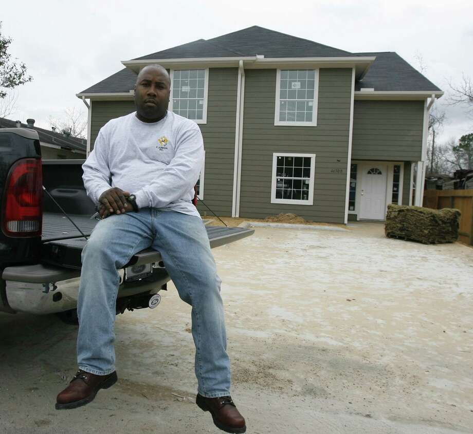 Houston  Developer Dwayne Jordon in front of one of his many developments in the Sunnyside neighborhood of Houston in January 2007. Photo: Billy Smith II / Houston Chronicle