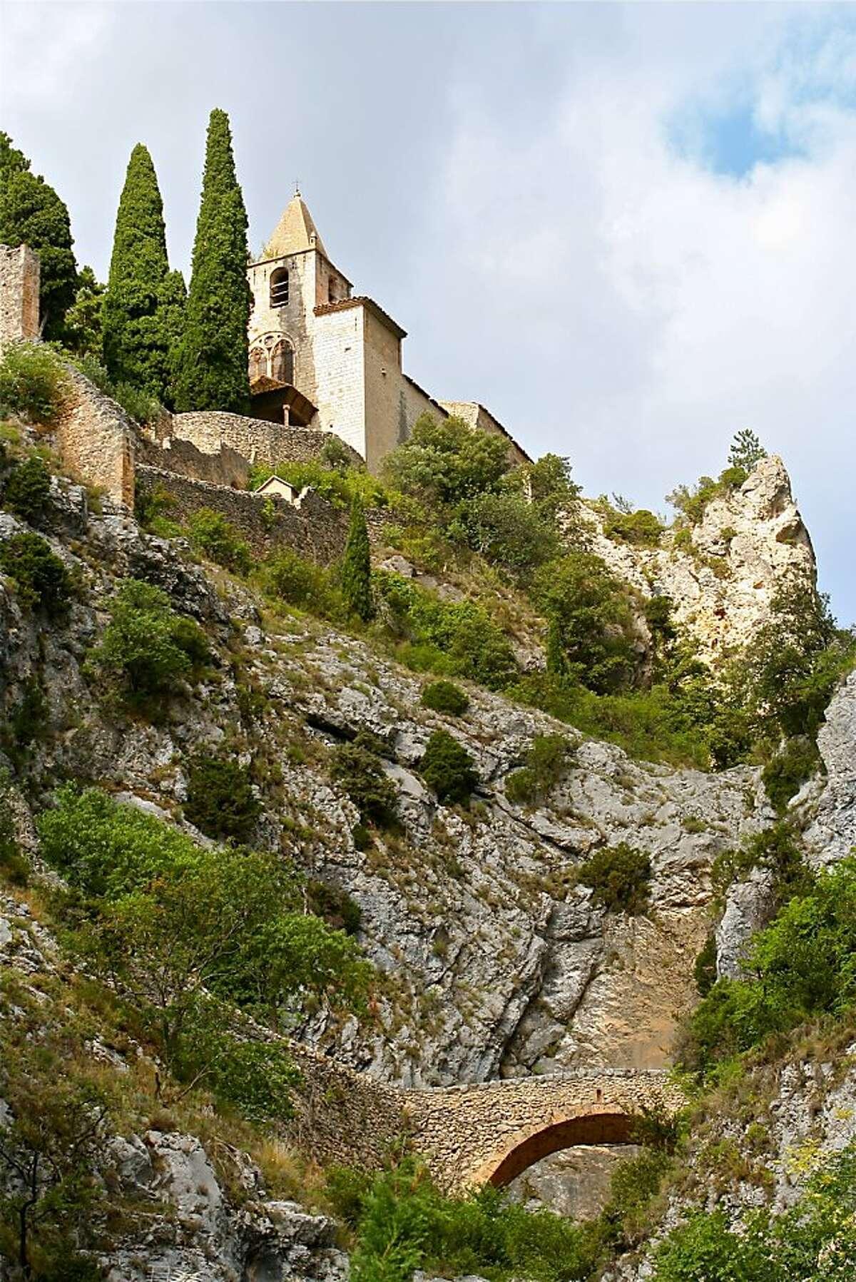 Stone steps up a pilgrim's path lead to the 12th-century chapel, Notre-Dame de Beauvoir.