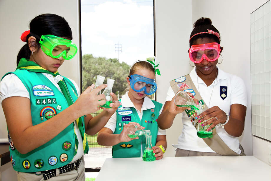 From left, Girl Scouts Linh Nguyen, Cecilia Weatherford and Keturah Crease explore the properties of liquids.