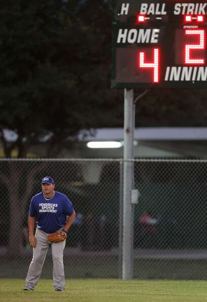 Roger Clemens gets set in the outfield. (Karen Warren / Houston Chronicle)