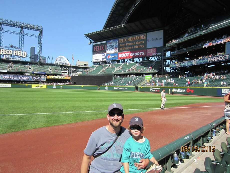 Jameson Connolly, right, and his dad, Steve, at their second perfect game. (Courtesy Steve Connolly)