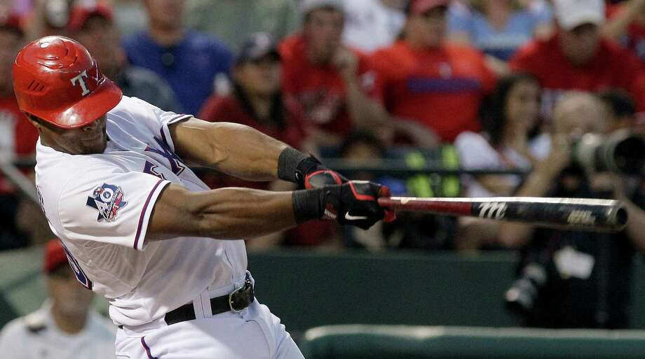 Bulging muscles plus full bat extension equals the second of three home runs by Adrian Beltre in an eye-popping display of power. Photo: LM Otero / AP