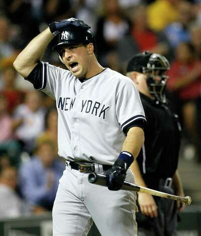 New York Yankees' Mark Teixeira yells out after home plate umpire Mike Muchlinski called strike two during the ninth inning of a baseball game against the Chicago White Sox, Wednesday, Aug. 22, 2012, in Chicago. Teixeira eventually struck out swinging and the White Sox won 2-1, sweeping the three game series. (AP Photo/Charles Rex Arbogast) Photo: Charles Rex Arbogast
