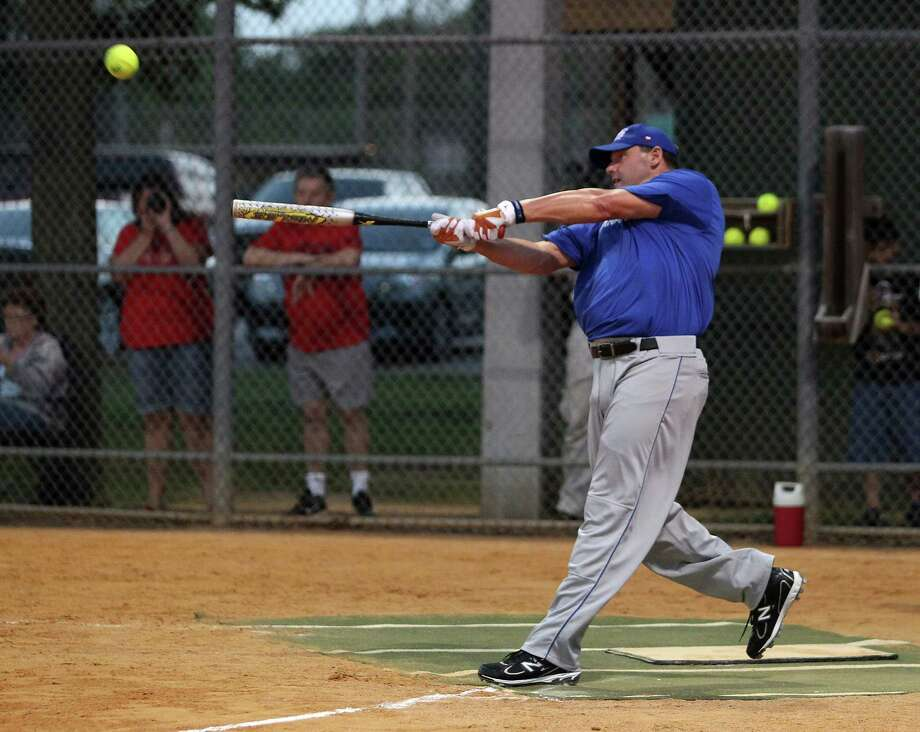 Roger Clemens tunes up for Saturday's pitching outing with the Sugar Land Skeeters by cranking it up at the plate on behalf of a men's over-50 softball team Wednesday night. Although he had several hits, his biggest blast sailed over the wall … foul. Photo: Karen Warren / © 2012  Houston Chronicle