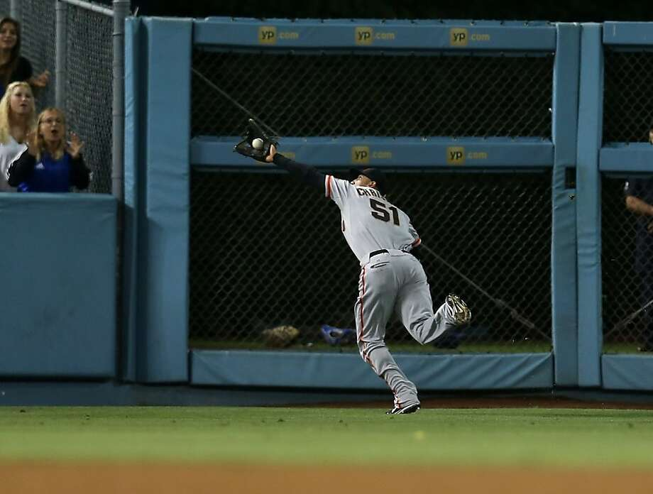 LOS ANGELES, CA - AUGUST 22: Left fielderJustin Christian #51 of the San Francisco Giants makes a running catch on a line drive hit by Juan Rivera of the Los Angeles Dodgers in the seventh inning on August 22, 2012 at Dodger Stadium in Los Angeles, California.  (Photo by Stephen Dunn/Getty Images) Photo: Stephen Dunn, Getty Images