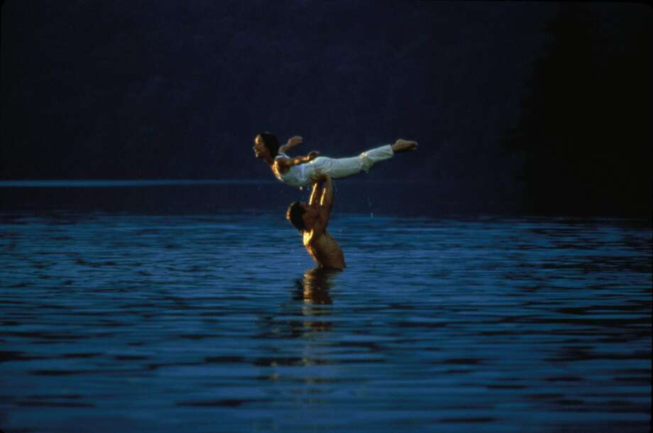 "Jennifer Grey and Patrick Swayze practice their dance steps in the lake in ""Dirty Dancing."" (Lionsgate Home Entertainment)"