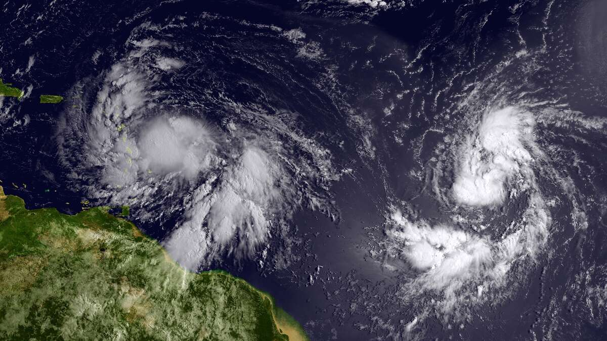 A satellite image of Tropical Storm Isaac. A new tropical depression approaches at left. (National National Oceanic and Atmospheric Administration)