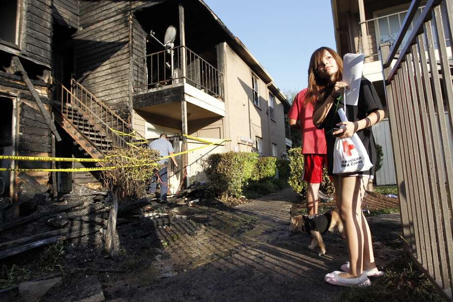 Esbayde Michel,20, views her damaged apartment where she was forced to jump out the balcony to save her life on Aug. 23, 2012 in Houston. ( Mayra Beltran / Houston Chronicle )