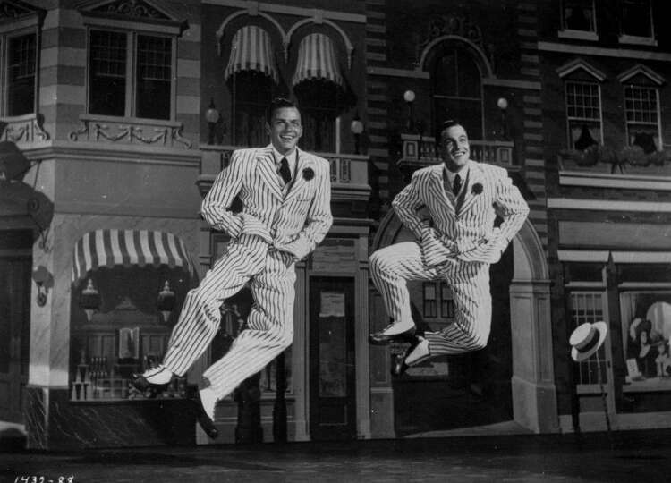 Frank Sinatra, left and Gene Kelly combined their talents in a 1949 photo of a scene from