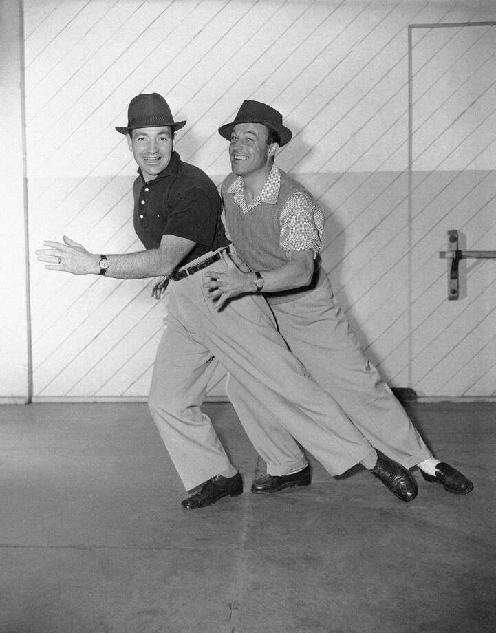 "In this photo provided by MGM, it's Kelly on the double with the arrival of Gene Kelly's brother Fred, left, to make his screen debut with Gene in ""Deep in My Heart"", story of Sigmund Romberg and his music, May 3, 1954. Photo: AP"
