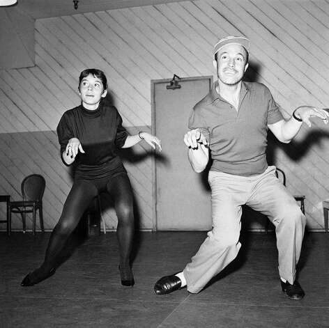 Judith Dornys of Germany, rehearses with Gene Kelly, April 14, 1959 in preparation for his TV musical special. Photo: AP