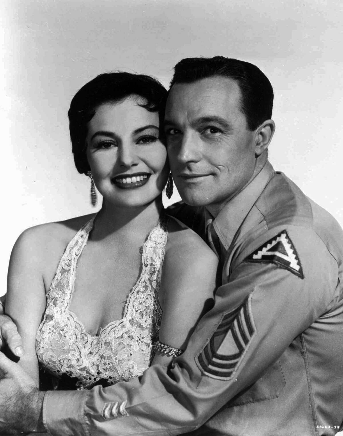 FILE--Cyd Charisse and Gene Kelly, shown in this undated file photo, combined their singing and dancing talents in the movie