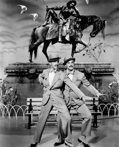 "Fred Astaire and Gene Kelly danced together in only one film, ""Ziegfeld Follies of 1946.""     But what a teaming it was!   ""I'd change my name to Ginger if we could do it again,""   Kelly declares in MGM's ""That's Entertainment!,""  a  1974  United Artists release.  Photo: Anonymous, ASSOCIATED PRESS / AP Images"