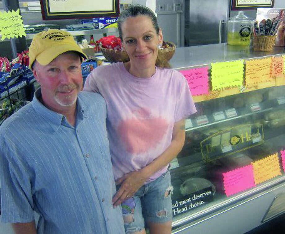 Joe Hinckley and Beverly Jajer have set up shop in New Milford and are enjoying their ownership of the Merryall Market. August 2012 Photo: Contributed Photo