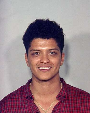 "In this handout provided by the Las Vegas Metropolitan Police Department, musician Peter Hernandez, better known as ""Bruno Mars,"" poses for a mug shot at the Clark County Detention Center. The singer/songwriter was arrested and charged with possession of a controlled substance after officers found him with 2.6 grams of cocaine at the Hard Rock, Las Vegas, September 19. 2010."