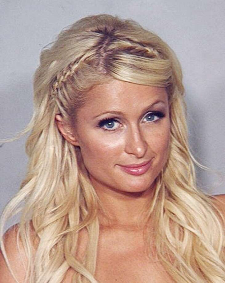 Paris Hilton — seen here in her booking photo — was arrested after being stopped on the Las Vegas Strip in a black Cadillac Escalade by a police motorcycle officer who smelled marijuana smoke coming from the vehicle driven by Cy Waits, her boyfriend at the time. Hilton was charged with suspicion of felony cocaine possession after police found a small amount of cocaine in her purse.