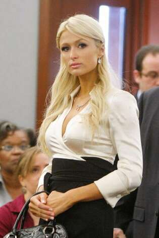 Paris Hilton appearing in court at the Clark County Regional Justice Center September 20, 2010 in Las Vegas, Nevada. Hilton had pleaded guilty to two misdemeanors, drug possession and obstructing an officer, as part of a plea deal worked out with prosecutors following her August 27 arrest for cocaine possession on the Las Vegas Strip. As part of the agreement, In order to avoid jail time and a felony conviction, Hilton served a year of probation, paid a 2,000 fine, served 200 hours of community service and completed a drug abuse program. (Isaac Brekken / Getty Images)