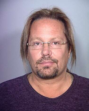 In this handout provided by the Las Vegas Metropolitan Police Department, rocker Vince Neil is seen in a booking photo at the Clark County Detention Center, February 15, 2011 in Las Vegas, Nevada. Neil was beginning a 15-day jail sentence for a DUI conviction. (Las Vegas Metropolitan Police Department / Getty Images)
