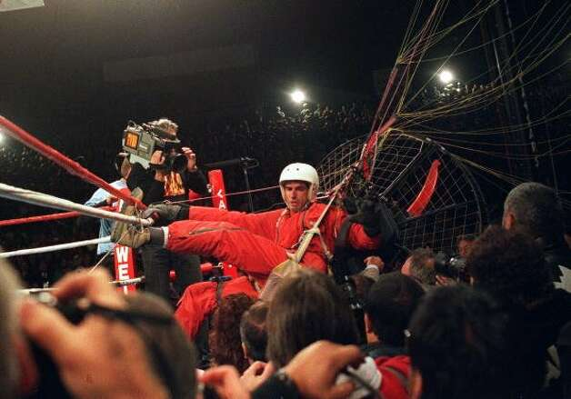 "Parachutist James Miller, also known as ""Fan Man,"" crashed into the boxing ring during the Riddick Bowe VS. Evander Holyfield World Heavyweight tittle fight in Las Vegas, Nevada, Nov 6, 1993. Miller was immediatley arrested for making an unscheduled landing that caused the anticipated fight to be delayed.  (Getty Images)"