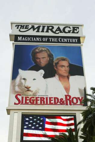 A poster advertising a performance by Siegfried and Roy is seen at the Mirage Hotel October 4, 2003 in Las Vegas, Nevada. Magician Roy Horn was attacked by a seven year old white tiger called Montecore, who was appearing on stage for the first time, during a performance at the Mirage Hotel. The attack had left him in  critical condition in University Medical Center on October 3.  (Carlo Allegri / Getty Images)