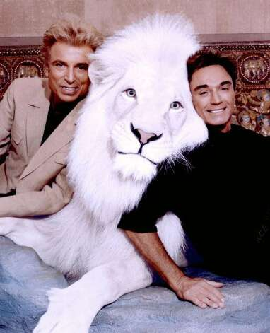 In this undated photo magicians Siegfried (left) & Roy pose with one of their white tigers. Horn, 59-years-old, was mauled and critically injured by a white tiger while performing onstage at the Mirage Resort October 3, 2003 in Las Vegas, Nevada. Horn was left in critical condition and taken to University Medical Center in Las Vegas for immediate surgery.  (The Mirage Resort / Getty Images)