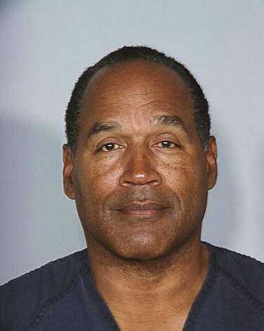 In this photo released October 3, 2008 by the Las Vegas Metro Police Department, O.J. Simpson is seen after he was taken into custody after a 12 count robbery conviction. Simpson was convicted of robbing two sports-memorabilia dealers in a hotel room in Las Vegas at gunpoint. (Las Vegas Metro Police Department / Getty Images)