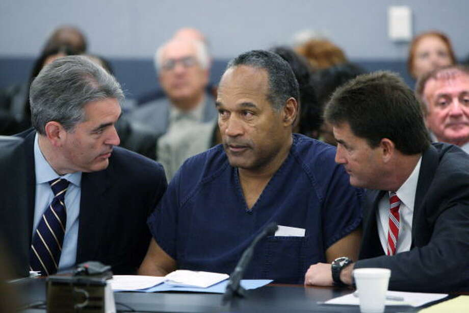 O.J. Simpson (center) was jailed in Nevada on charges including felony kidnapping, armed robbery and conspiracy related to a 2007 confrontation with sports memorabilia dealers in a Las Vegas hotel.