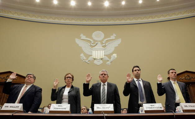 Government Services Administration Inspector General Brian Miller, former GSA Administrator Martha Johnson, GSA Regional Commissioner Jeff Neely, GSA Chief of Staff Michael Robertson and GSA Deputy Commissioner David Foley are sworn in before testifying to the House Oversight and Government Reform Committee on Capitol Hill April 16, 2012 in Washington, DC. Johnson resigned from the GSA after it was published that the agency spent about $823,000 on a 2010 Las Vegas convention for 300 employees, including thousands of dollars spent on items such as a commemorative coin set, a mind reader, a comedian and a clown. Several other officials had resigned, been fired or suspended in the wake of the scandal.  (Chip Somodevilla / Getty Images)