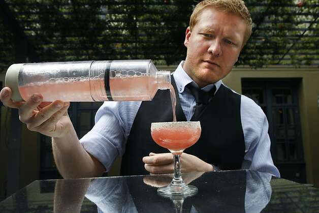 Chez Papa general manager Adam Chapman shows how to make a Watermelon Carolina Cross using his Perlini carbonated cocktail shaker in San Francisco, Calif., on Tuesday, August  14, 2012. Photo: The Chronicle
