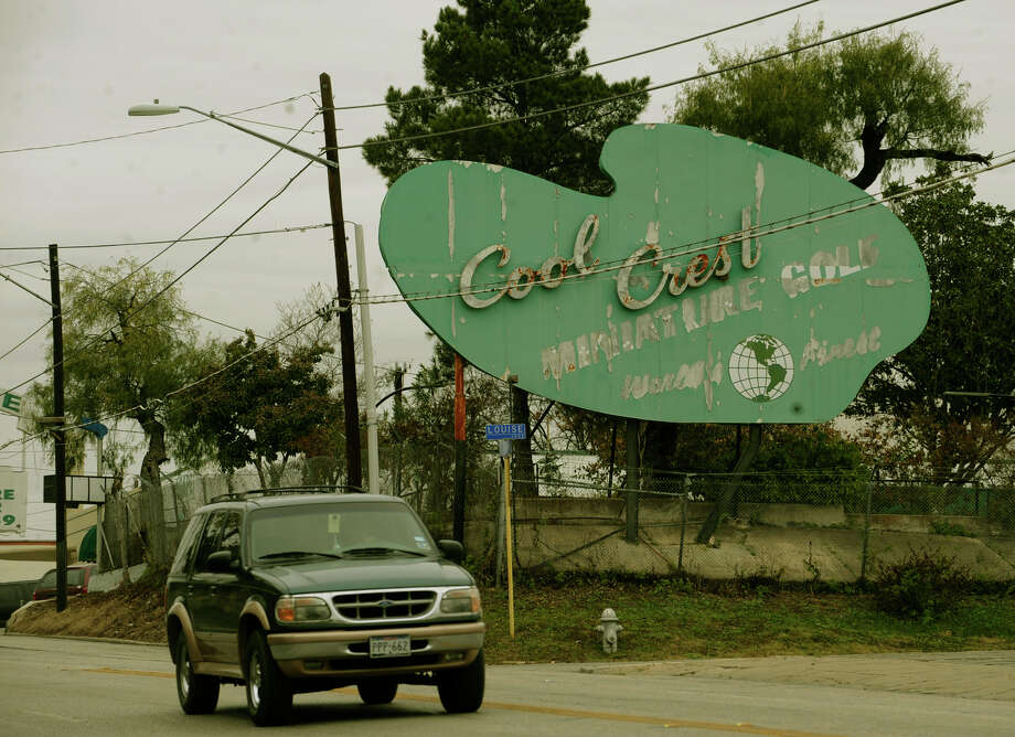 The distinctive Cool Crest Miniature Golf sign is a prominent sight on Fredericksburg Road  and one of the city's historic roadside treasures.  Photo: Billy Calzada, For The Express-News / SAN ANTONIO EXPRESS-NEWS