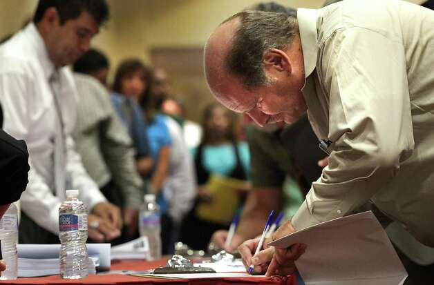 Tom Brandon of New Braunfels, signs up at the Job Fair at the Texas Economic Developement & Energy Summit held at the Henry B. Gonzalez Convention Center, Thursday, August 23, 2012. Photo: BOB OWEN, San Antonio Express-News / © 2012 San Antonio Express-News